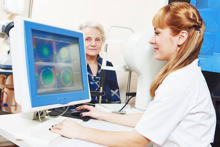 Optometry concept. female optometrist optician doctor evaluate eyesight of female patient in eye ophthalmological clinic Zdjęcie Seryjne