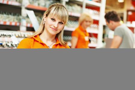 Positive female seller or shop assistant portrait  in hardware supermarket store Archivio Fotografico