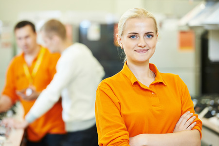 retail: Positive seller or shop assistant portrait  in supermarket store Stock Photo