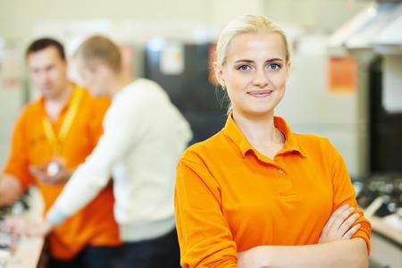 Positive seller or shop assistant portrait  in supermarket store Foto de archivo