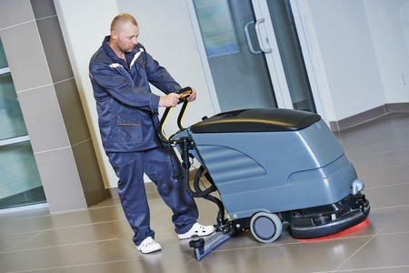 factory floor: Floor care and cleaning services with washing machine in business centre hall