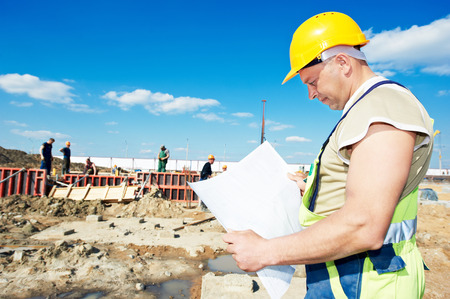 mounter: construction builder worker with blueprint project at building site