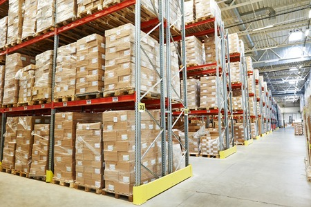 interior of modern warehouse. Rows of shelves with boxes Archivio Fotografico