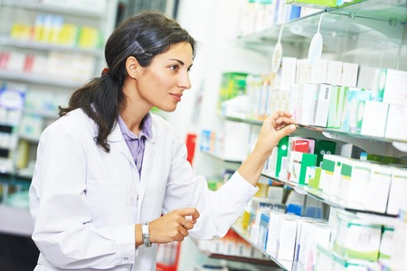 portrait of female pharmacist chemist woman in pharmacy drugstore