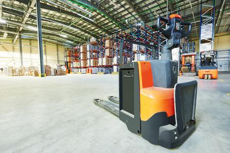 stacker: Manual forklift pallet stacker truck equipment at warehouse