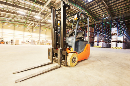 unloading: forklift loader pallet stacker truck equipment at warehouse