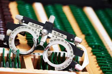 Optometry concept. test glasses phoropter with lens set for eye sight vision testing or examinations in clinic