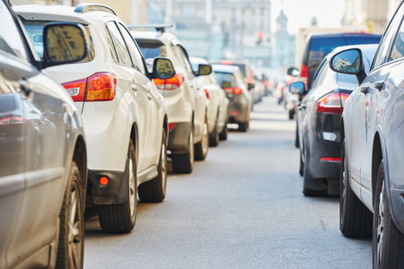 stop pollution: urban traffic jam in a city street road during evening rush hour