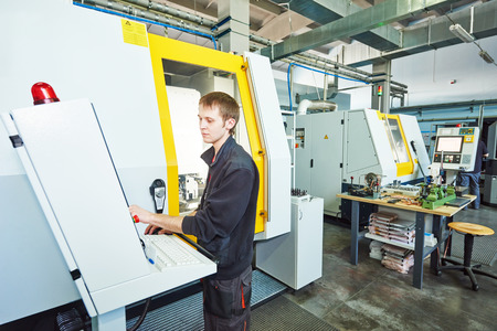 machine tool: mechanical industrial worker at cnc milling machine center in tool manufacture workshop