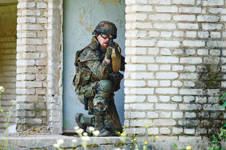 assault rifle: military. soldier targeting  with assault rifle at position in nato germany uniform indoors Stock Photo