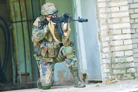 nato: military. soldier targeting  with assault rifle at position in nato germany uniform indoors Stock Photo