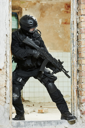 antiterrorist: Military industry. Special forces or anti-terrorist police soldier,  private military contractor armed with weapon during clean-up operation, mission Stock Photo