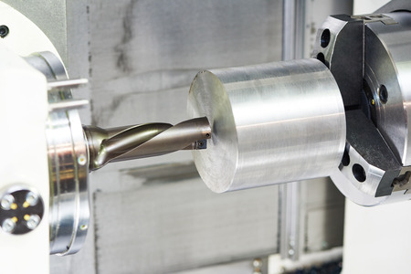 machine tool: metal working. Process of detail drilling or counterboring on machine by drill cutter tool during turning at factory.