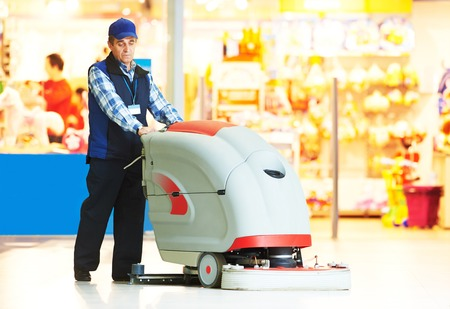 floor standing: Floor care and cleaning services with washing machine in supermarket shop store