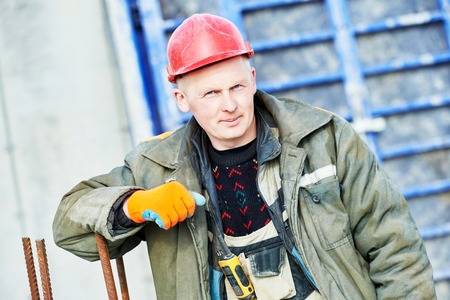 rigger: construction concreter builder labour worker at building site Stock Photo