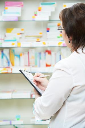 merchandiser: pharmacist chemist woman working in pharmacy drugstore