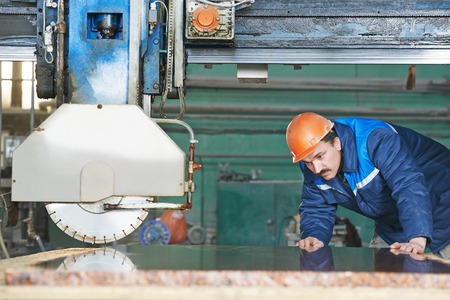 industrial: Industrial worker at factory on granite or marble manufacture Stock Photo