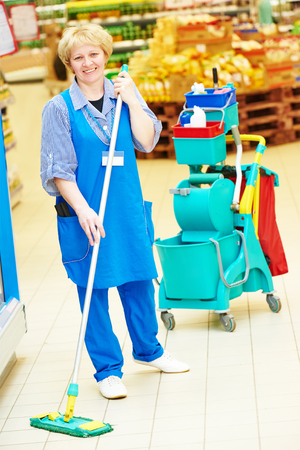 Floor care and cleaning services with mop in supermarket shop store