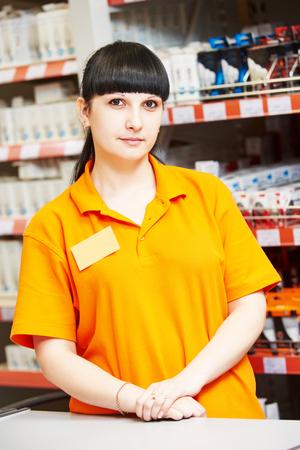 merchandiser: Positive female seller or shop assistant portrait  in hardware supermarket store Stock Photo