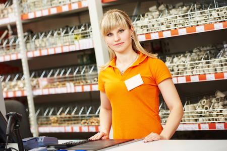 assistant: Positive female seller or shop assistant portrait  in hardware supermarket store Stock Photo