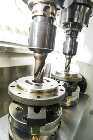 milling: Metalwork industry. Twin milling machine tool with two mills in spindel ready to process metal detail at industrial manufacture factory