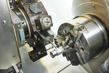 cutting tool: metalworking  industry: mill cutting tool ready to process steel metal shaft on lathe machine in workshop