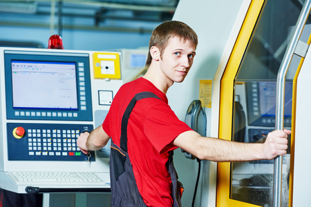 maintenance fitter: mechanical industrial worker at cnc milling machine center in tool manufacture workshop