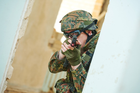 nato: military. soldier with pistol in nato germany uniform indoors Stock Photo