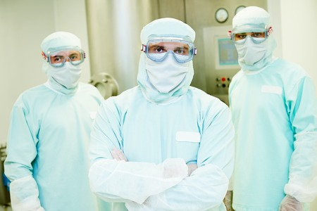 pharmaceutical staff workers team in protective uniform at pharmacy industry manufacture factory