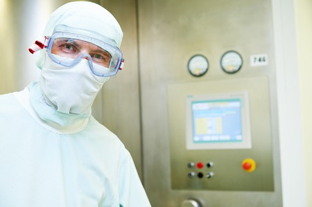 pharmaceutical staff worker in protective uniform at pharmacy industry manufacture factory