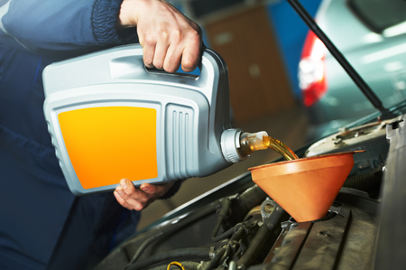 automobile workshop: Car servicing, oil and filter replacing maintenace