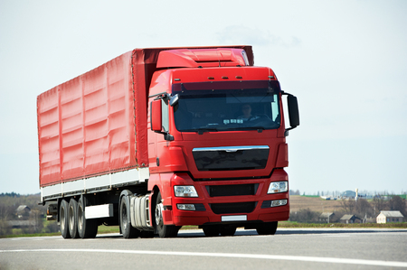 hauling: Lorry with trailer on highway autobahn interstate road