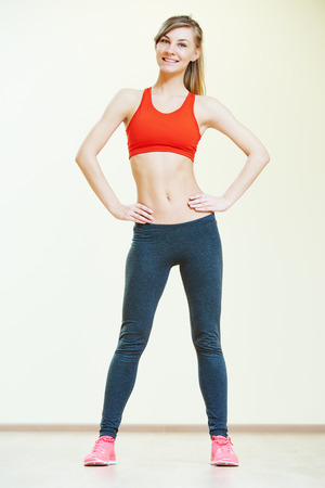 women sport: fitness instructor doing pilates or dancing exercises in sport club