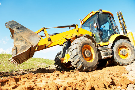 wheel loader: wheel loader excavator earthmoving sand and soil at construction site Stock Photo