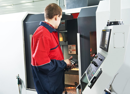 machining center: mechanical technician service engineer worker at cnc metal machining milling center in tool workshop