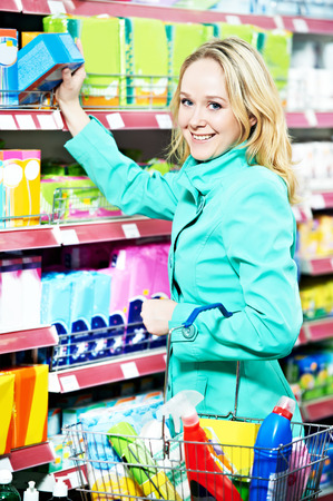 toiletries: smiling woman shopping toiletries and household cleaning supplies goods.