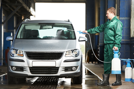 pressured: manual car washing cleaning with foam and pressured water at service station