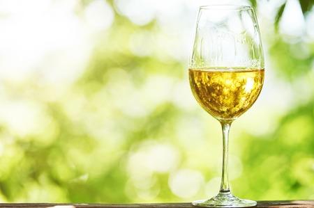 chardonnay: Glass of Chardonnay, Sauvignon or Rkatsiteli white wine over outdoors background