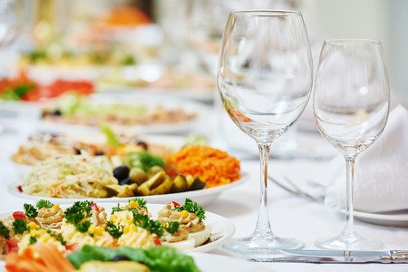 Catering services. glasses set and dish with food meal in restaurant 写真素材