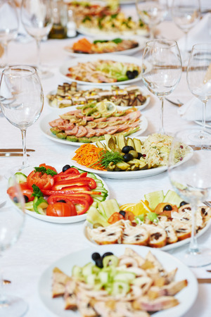 holiday catering: Catering services. glasses set and dish with food meal in restaurant Stock Photo