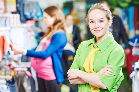 merchandiser: Portrait of sales assistant or seller in baby product shoppping center Stock Photo