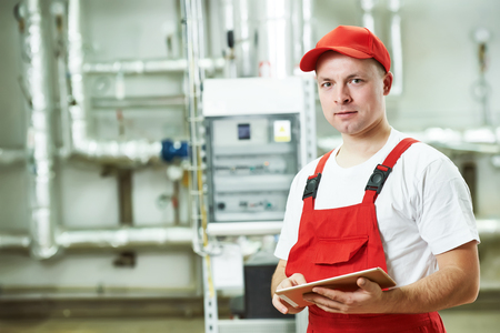 Technician maintenance repairman engineer inspector in heating system of boiler room Stock Photo - 48492615