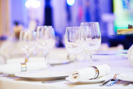 holiday catering: catering services background with glasses for wine on table in restaurant