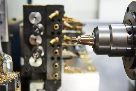 ncc: Metalworking industry. close-up view of brass detail during cutting process on moderm machining center Stock Photo