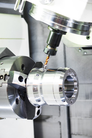 tool chuck: metalworking industry. drilling a hole on modern metal working machining center Stock Photo