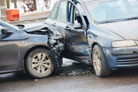 accident body: Car crash accident on street with damaged automobiles after collision