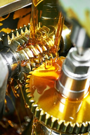 metalworking industry. tooth gear cogwheel machining by hob cutter mill tool. Authentic shot in challenging conditions. maybe little blurred