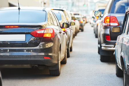 stop pollution: Urban traffic jam with rows of cars in a city street road during rush hour