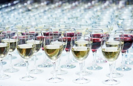 holiday catering: catering services. rows of glasses with wine at restaurant party or celebration Stock Photo