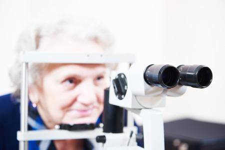 ocular diseases: optical medical devices used for eyesight examination of senior woman. Shallow DOF